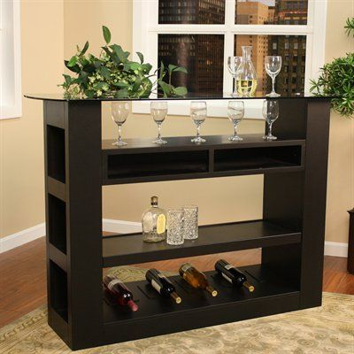 Greystone 9000092 Lazio Wine Home Bar, Black  List Price$831.73Price$715.00Out of Stock Wine Storage and open storage on sides Open shelving for ample storage FinishBlack MaterialsCustom Select Hardwood, Poplar Veneers, Glass Weight150 Pounds Width21 inches Length5 feet 1 inch Height3 feet 6 inches Weight150lbs