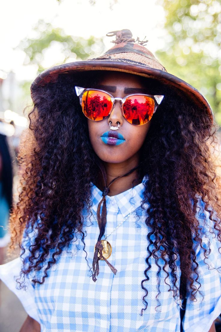 We're calling it: The conical hat is the new floppy brim. #refinery29 http://www.refinery29.com/2015/08/91360/afropunk-2015-music-festival-street-style-pictures#slide-3