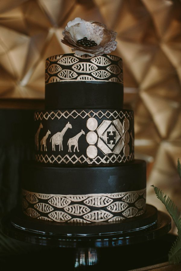 black and gold wedding cake - photo by Megan Saul Photography http://ruffledblog.com/modern-safari-wedding-inspiration #weddingcake #cakes