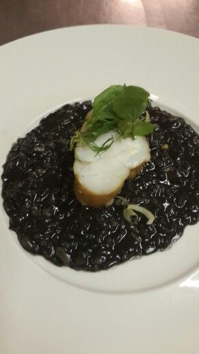 Smoked monk fish with squid ink risotto