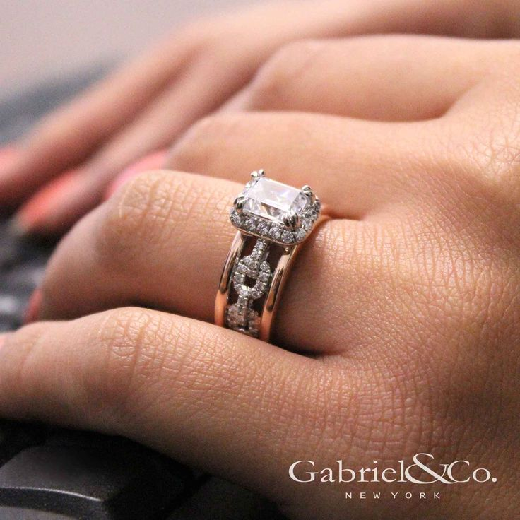 Gabriel & Co. - Voted #1 Most Preferred Bridal Brand.   A modern take to the White/Pink Gold Emerald Cut Halo Engagement Ring.