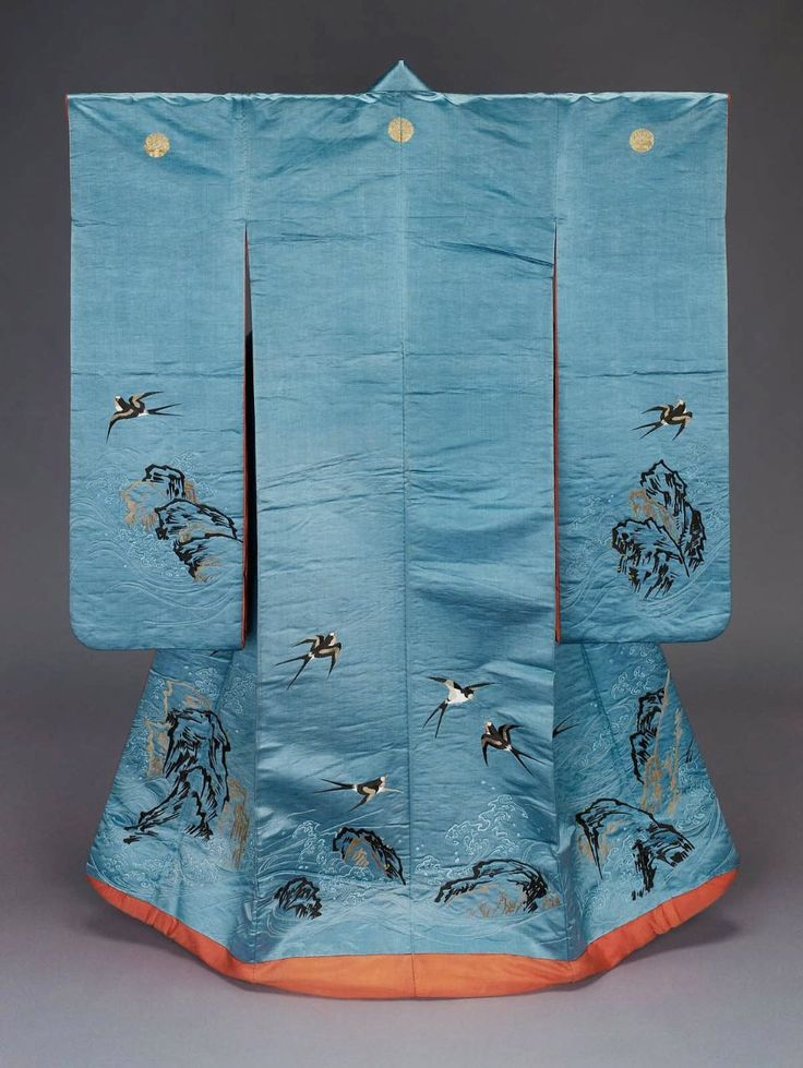 """Furisode kimono, first half 19th century, Japan. """"Long-sleeved robe (furisode) with design of swallows (tsubame), cliffs and waves embroidered with various shades of brown, yellow, white, red and blue silk; three crests couched with gold metallic thread across the upper back; lined with reddish-orange silk and padded at bottom. Silk satin with silk and gilt-paper embroidery""""  MFA. (William Sturgis Bigelow Collection)"""