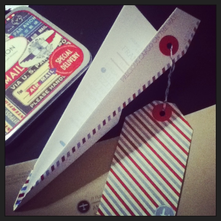 A paper airplane invite for a vintage #airmail #babyshower