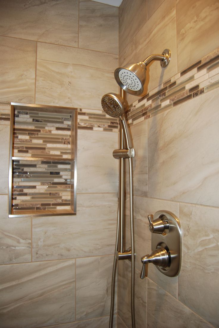 Tiled shower surround with brushed nickle fixtures! Fixed and removable shower…