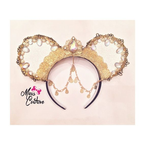 Another version of the original Arabian Princess Ears, this time with Opal coloring so that brilliant color flashes of every range are present. Like the originals, these are covered in sparkle and dripping with gorgeous jewels and medallions, just enough to exude the essence of royalty! Made to Order. *Hanging charms may differ depending on availability*