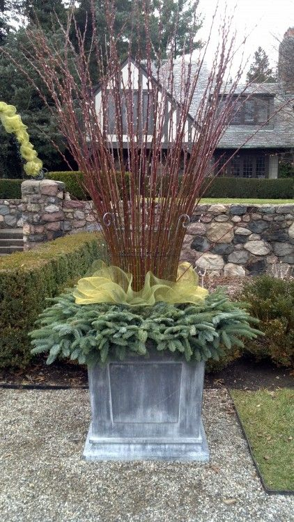 Love this Christmas Garden Urn with Wreath and Twigs-I love to add a touch of Christmas, to my garden!