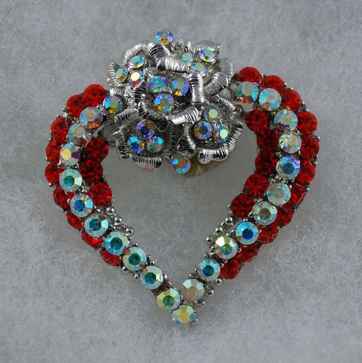 A personal favorite from my Etsy shop https://www.etsy.com/ca/listing/117423955/red-and-clear-heart-with-flower-brooch