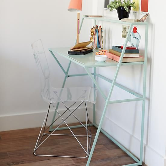 Our new Metalwork Desk (available in mint and grey) is the perfect for small spaces and features a streamlined design with a spacious desktop and functional shelf for books.