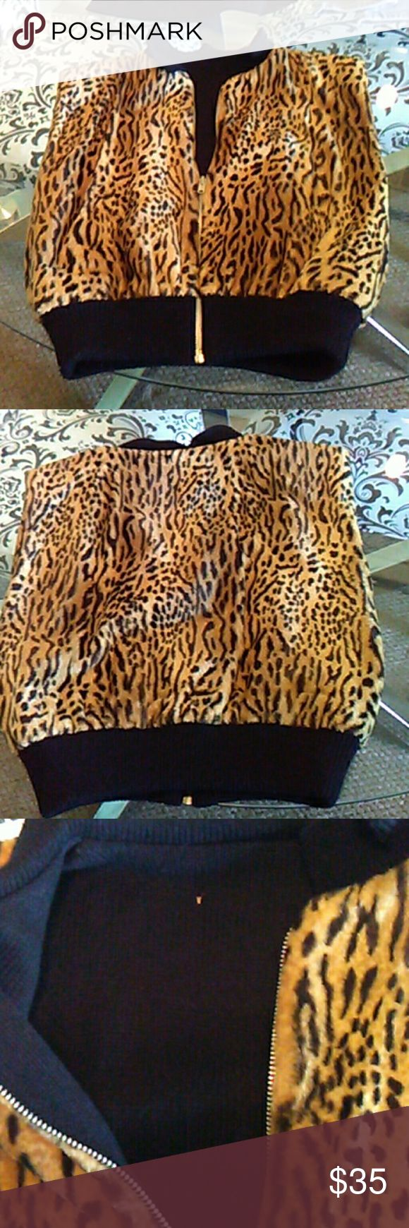 Vintage leopard  sweater vest. So rad ! Beautiful soft sweater vest. Small hole inside, on black sweater, not through fur  Easy fix.  Great condition otherwise. It is reversible, if not for hole which I can't sew, I would want $100 for it Really soft and beautiful. Vintage Tops