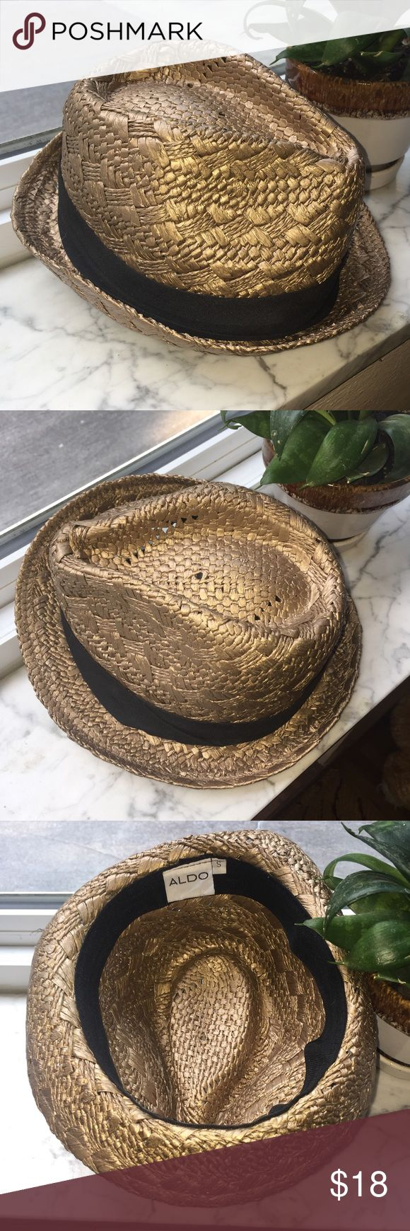 Gold Straw Fedora Gold straw fedora hat from Aldo. Never worn. It's a little warped from storage, but it goes back to its shape and looks perfect when worn. Let me know if you have any questions! Aldo Accessories Hats