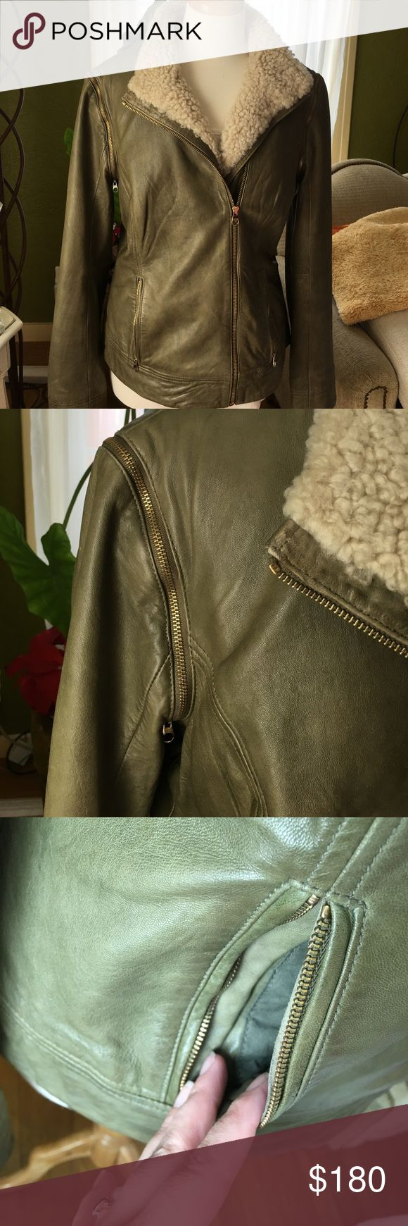 Ted baker -Olive green leather jacket -final price Gorgeous leather jacket - the sleeves un-zip - no rips or holes - material info show in photos- size 4 Ted baker size = size 10 U.S per Ted baker website chart - double please check size Ted Baker Jackets & Coats