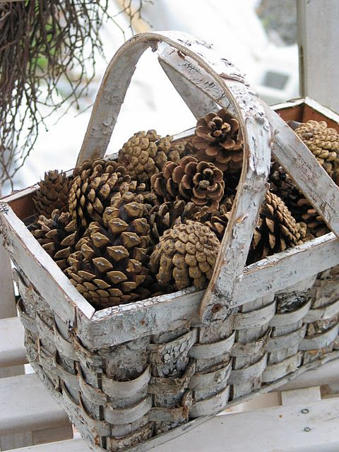 basket of pine cones, you can use twinkle lights, clear or colored, twining them around and through the pinecones and put them on your fireplace hearth and light them up....