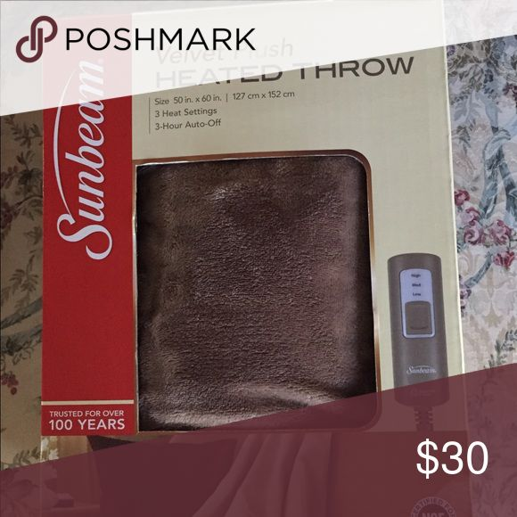 Velvet Plush Heated Throw Blanket Perfect for those crisp nights when you need a little extra warmth! Brand new and never opened. Got 2 for a gift so selling one! Sunbeam Other