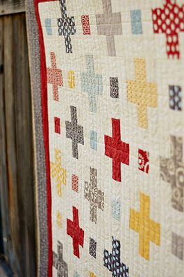 """Moda Bake Shop quilt using the Hometown line. Ingredients: 1 Jelly Roll of Hometown 1 5/8 yard Hometown cream (546812) for background 5/8 yards Hometown red (546811) for inner border (not shown) 1 yard grey floral (546725) for outer border 3 1/2 yards (546012) for backing 1/2 yard (546124) for binding 62"""" x 74"""" batting"""