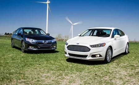 2013 Ford Fusion Energi Titanium vs. 2014 Honda Accord Plug-In Hybrid  Plug-Ins Go Mainstream: We compare two family sedans at the technology vanguard.