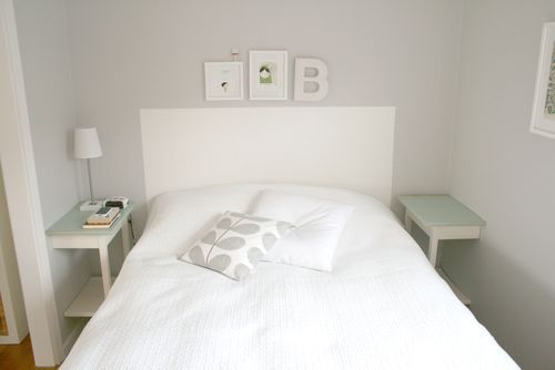 Limited for space or budget in the bedroom? Cut a inexpensive night table in half and anchor to the wall.