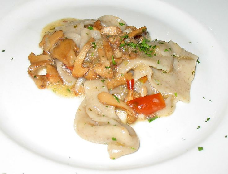 Hand made pasta with mushrooms from the hills in the San Cesario area
