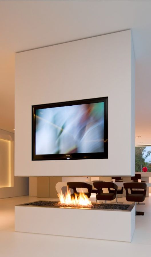Contemporary home with TV on the top of modern fireplace in living space interior design | See more Interior design inspiration ideas , http://www.brabbu.com/en/inspiration.php