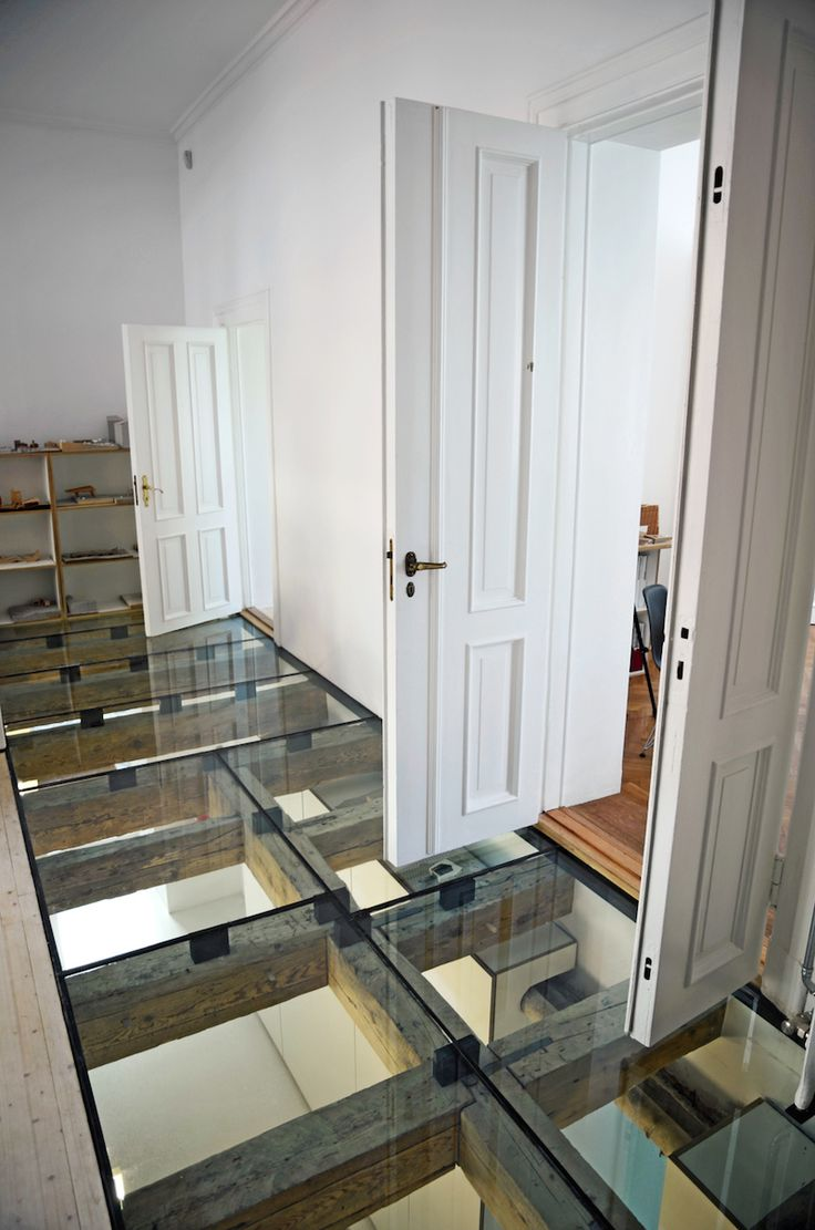 #Rustic beams are a stark contrast to these #contemporary glass floors