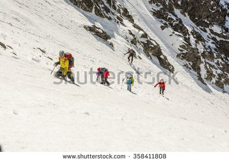 Vysne Hagy, Slovakia - March 29, 2014: Tourists on their way to the top of a very steep couloir.