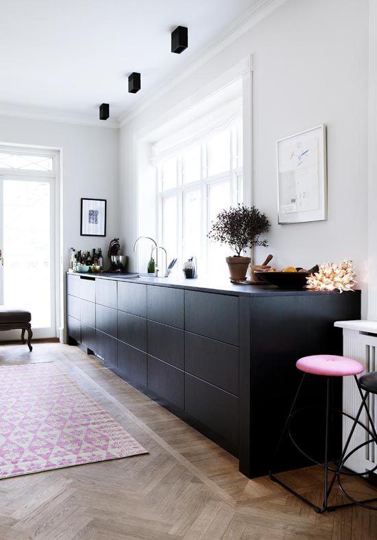 Sleek open space kitchen shot by Line Klein