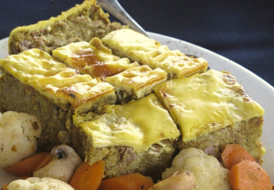 Bobotie: Bobotie, South Africa's most well-known Cape Malay dish, is traditionally made of spiced ground meat, then baked under an egg topping; imagine an egg-topped meatloaf with Winter spices.