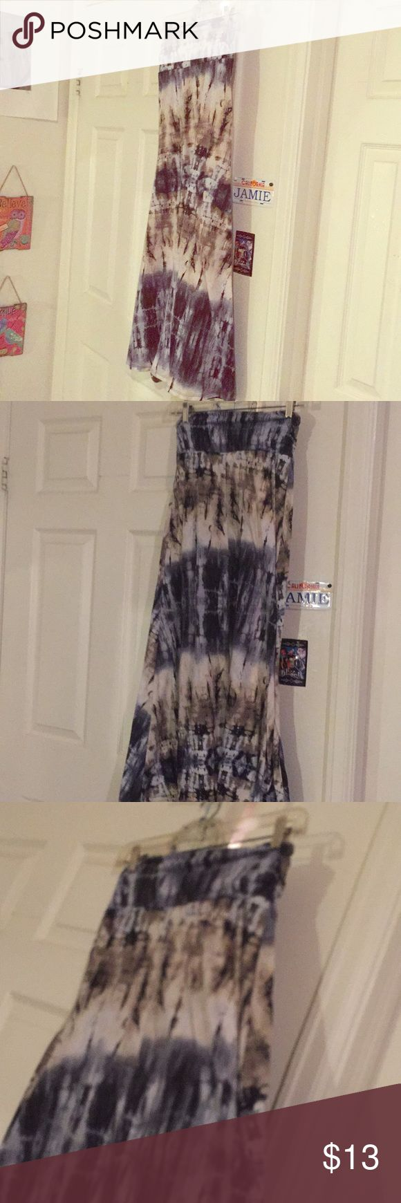 Tie dye dress! Only worn a handful of times! Can be worn as a long skirt or a cute tube top dress! Lots of compliments when wearing! Size large still very nice! Joe B Dresses