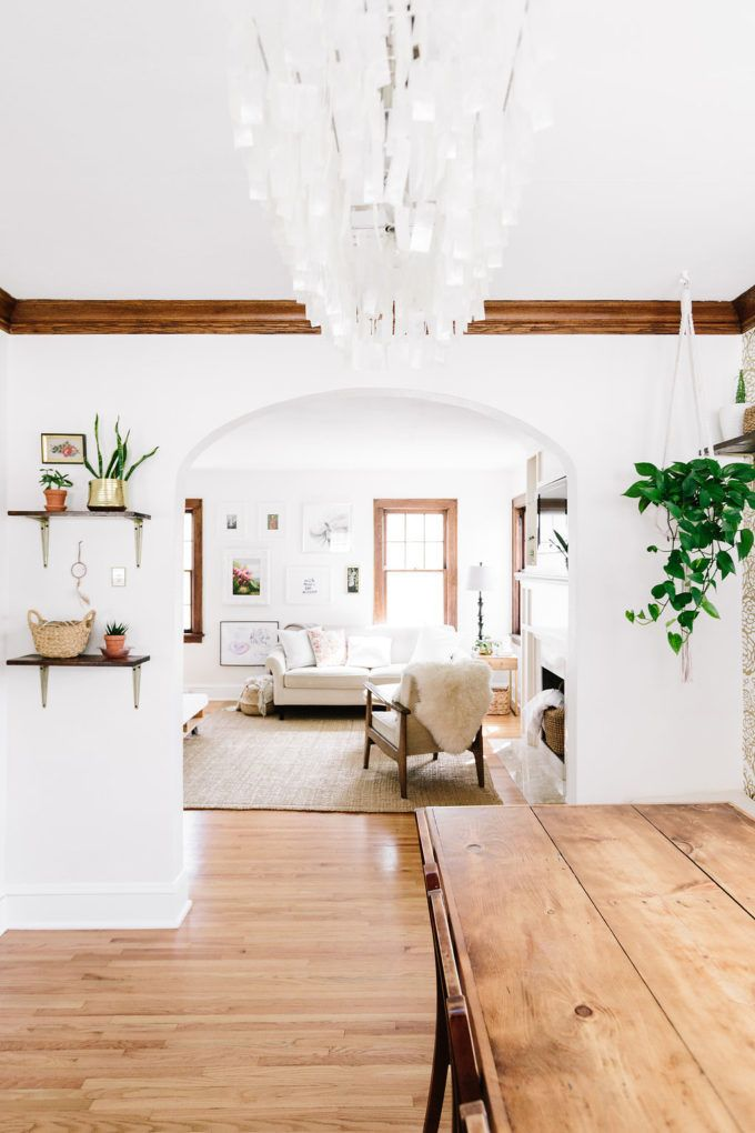 white walls, lots of wood, neutral browns, and plants