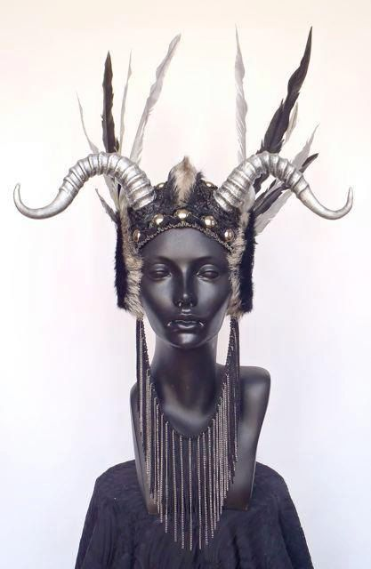 Who says belly dancers can't have horns??    MADE TO ORDER Faux Feather & Horn Headpiece. $425.00, via Etsy.