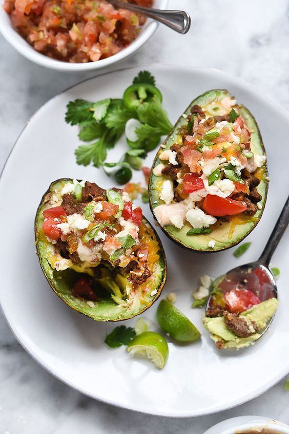 I love avocados and what a great idea for a different kind of taco packed with heart healthy fatty acids and cholesterol lowering properties. The avocado is a great topper for tacos, so why not really pack in the health benefits by making it the taco delivery vehicle of choice. Taco Stuffed Avocados | foodiecrush.com