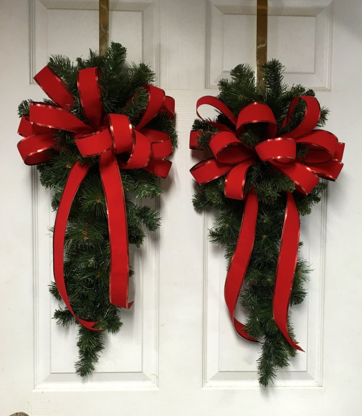 Lighted Clear Swags And Red Bow Outdoor Christmas Window