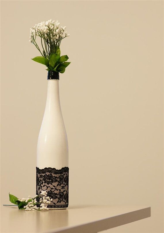 Wine bottle with lace & flowers