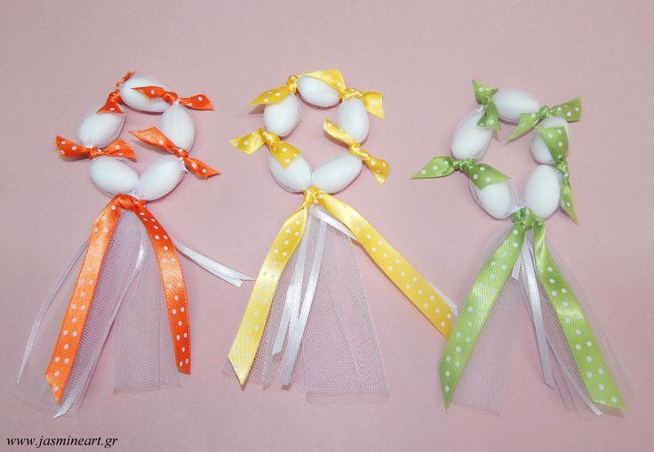 Μπομπονιέρες στεφανάκι  σ ε ανοιξιάτικα  χρώματα με πουά  κορδέλες