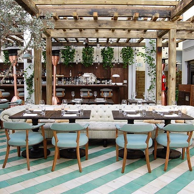 Cecconi's sits on the ground floor of Soho Beach-House in Miami. To evoke the signature glamour of the restaurant's London parent, but with a fresh Miami angle - the use of vibrant colors and patterns by way of an encaustic tiled two-colored diagonally striped floor and custom made furnitures and the hanging glass jars lights from the wooden beams. I can just imagine how magical this place must be at night with its twinkling illumination! ✨
