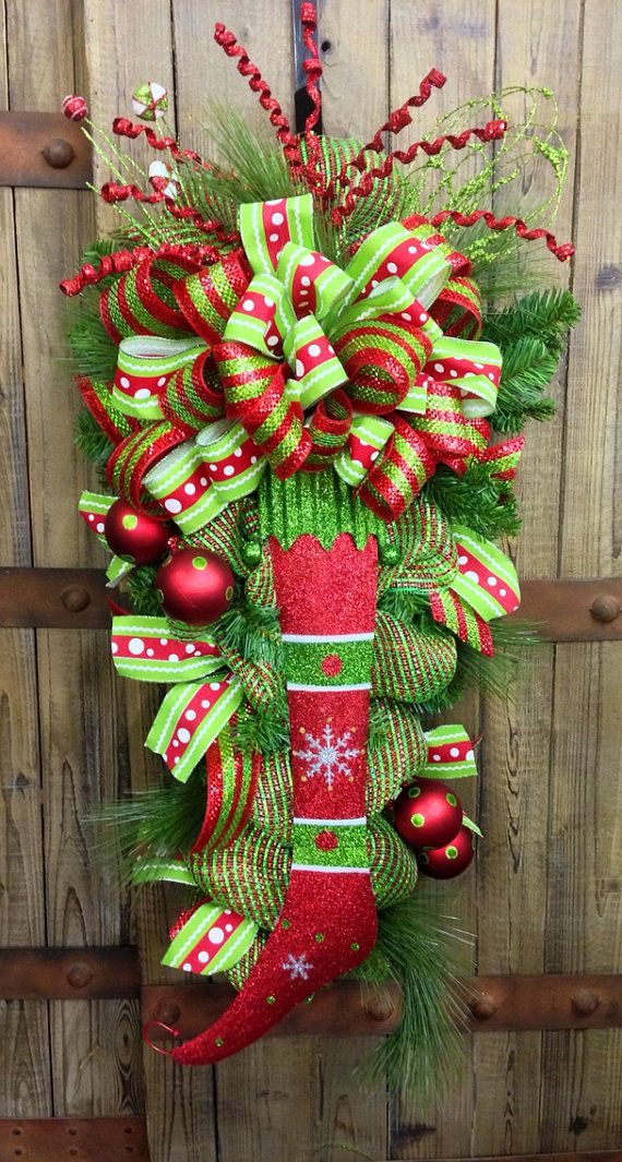 Whimsical Christmas Pine Door Swag. I'm beginning  to like swag's more than wreaths. Not as trendy!