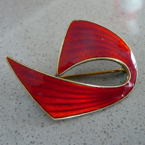 Aksel Holmsen Silver Enamel Red Ship Brooch. Another of those sweeping curve ship brooches, this time in deep red. Great design -- simple and elegant.