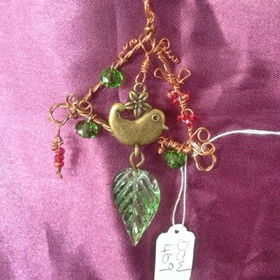 doinWire handcrafted copper wire Pendant. doinWire Handmade copper twisted vine frame with green and red crystals, wrapped with copper wire hearts with bird charm and leaf dangle. DOW469