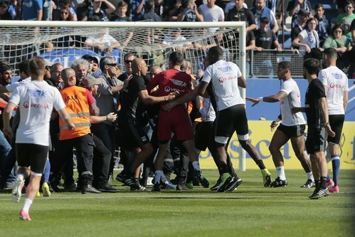 AP                  Published 11:36 a.m. ET April 16, 2017 | Updated 12 hours ago       Stewards and Lyon staff members try to stop Bastia's supporters who invade the pitch to fight with Lyon players during warm up prior to the French L1 Football match between Bastia (SCB) and...  http://usa.swengen.com/lyon-players-attacked-by-fans-in-bastia-during-french-league-match/