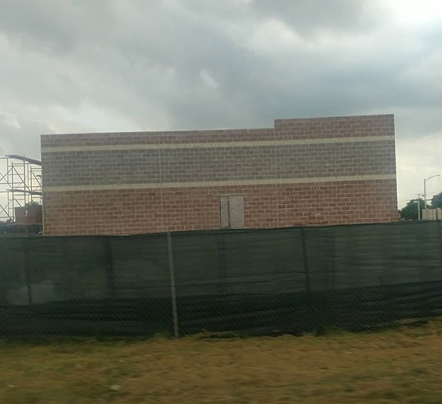 Two walls are up at the Baskin Robbins/Dunkin donuts store
