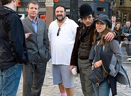 "Guy Ritchie, Joel Silver, Robert Downey Jr. and Susan Downey on the set of ""Sherlock Holmes"" (2009)."