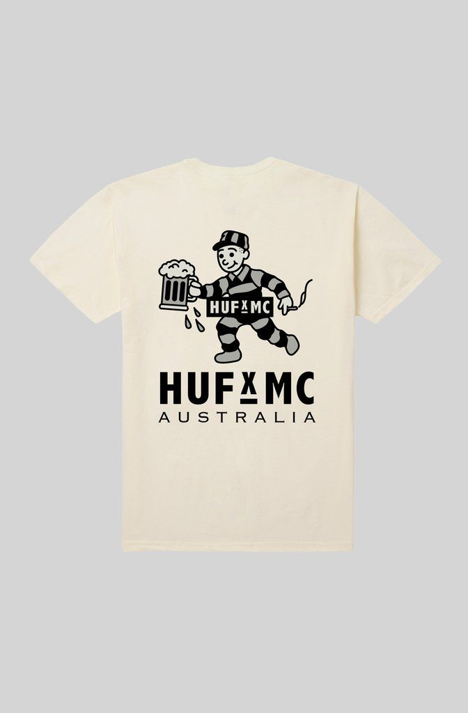 HUF x MC Bubbles Tee - Cream. In aid of the good times that we had with the HUF gang we've cooked up an exclusive collab. The logo, naturally, is a prisoner holding an ale: because most of us from 'down under' are descended from convicts, and liking beer's the one thing that we can all agree on.  Limited edition HUF x MC Range. Custom 'Bubbles' front pocket and large back print. 100% cotton tee.