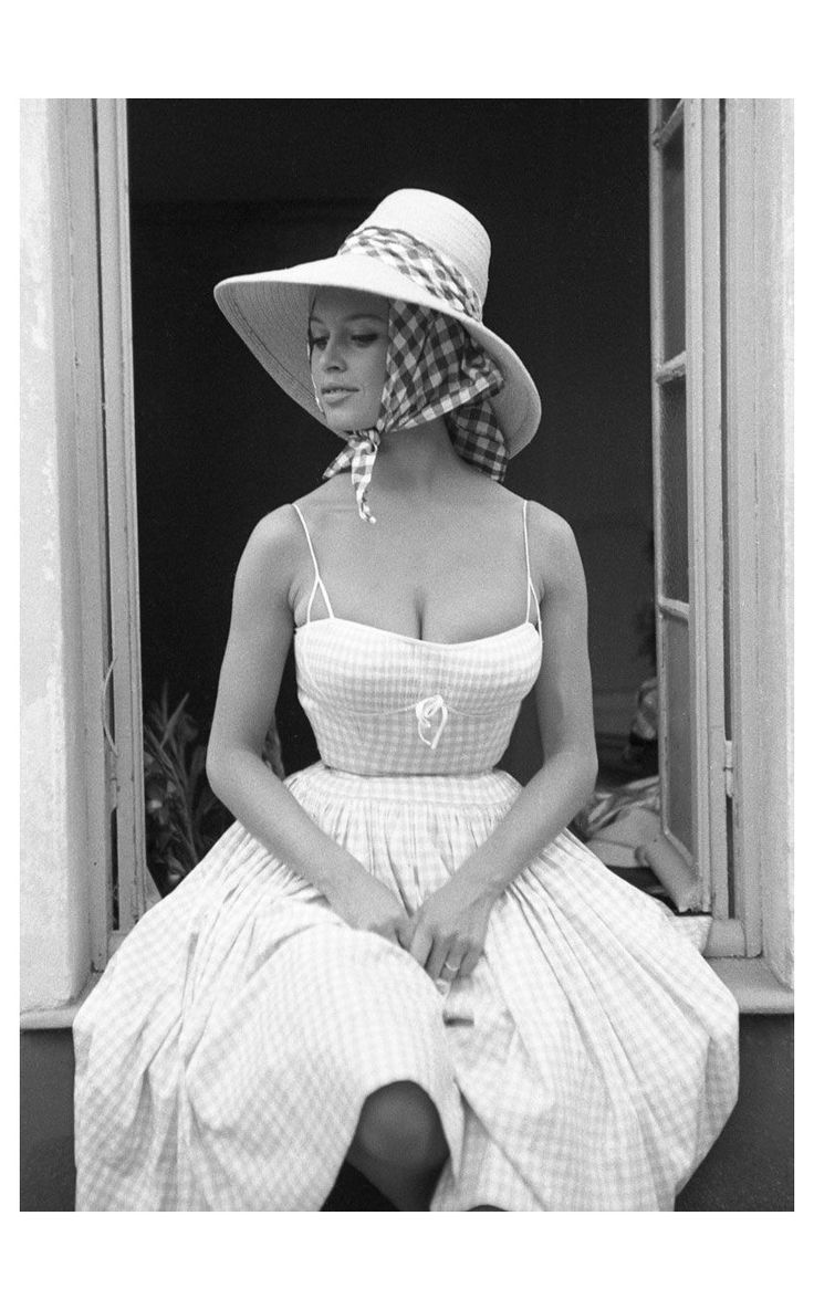 Brigitte Bardot wears a hat of French stylist Jean Barthet,and photographed for French ELLE, Paris 1961