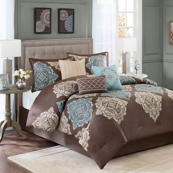 add a touch of texture to your master suite or guest bedroom decor with this chic comforter set showcasing a medallion motif in warm earthy tones