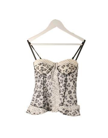 Top tipo corset estampado leopardo en blanco y negro con tirantes de cuero negros y cremallera. Lleva elástico. 90€