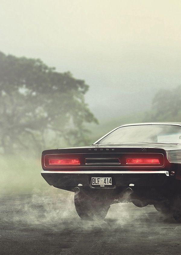 An old Charger spitting smoke.