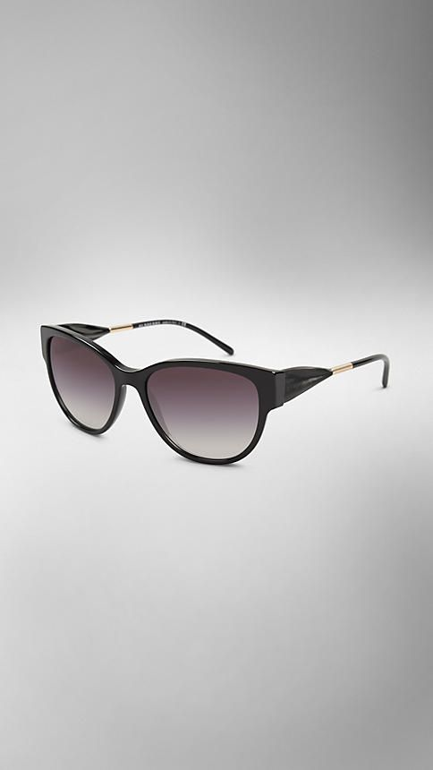 Burberry Black Cat-eye Sunglasses - Black cat-eye acetate sunglasses.  Tonal draped gabardine temples are inspired by the fabric of the trench coat, English-woven cotton gabardine, invented by Thomas Burberry in 1879.  Discover more accessories at Burberry.com