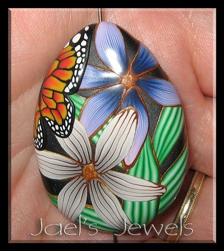 Monarch on black teardrop by jaelsjewels, via Flickr