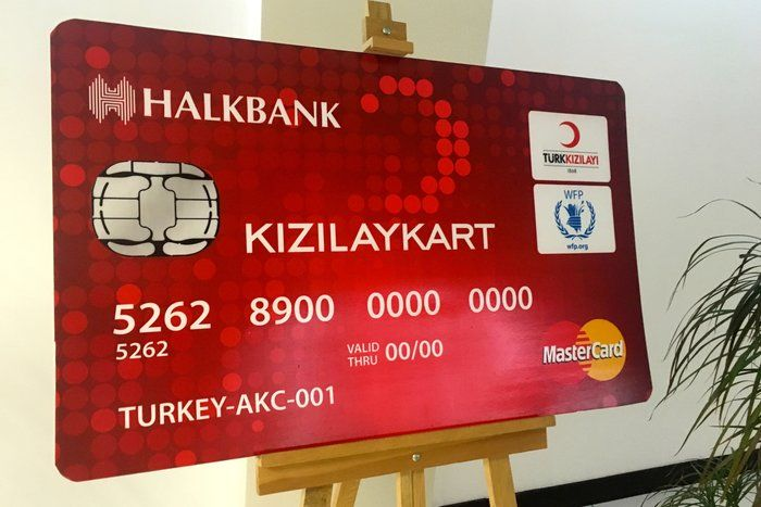 The European Union is giving the cards to Syrian refugees in Turkey. It's a massive project that will provide about $30 a person per month to the struggling families.