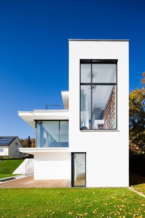 This house on a narrow site by German office Philipp Architekten follows the slope of its hilly location with a series of stepped levels