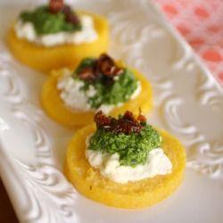Polenta Cakes with Goat Cheese and Kale Pesto--I like the idea of polenta cakes, anybody have a good topper idea?